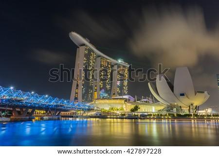 SINGAPORE - FEB 27, 2016: Night scene at Marina Bay Sands. Marina Bay Sand is one of the most famous tourist attraction in Singapore. / Helix Bridge singapore travel landmark  - stock photo