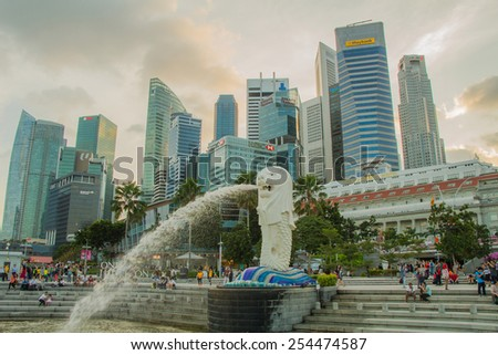 SINGAPORE-Feb 7, 2015: The Merlion fountain in Singapore. Merlion is a imaginary creature with the head of a lion,seen as a symbol of Singapore