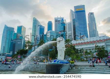 SINGAPORE-Feb 7, 2015: The Merlion fountain in Singapore. Merlion is a imaginary creature with the head of a lion,seen as a symbol of Singapore - stock photo