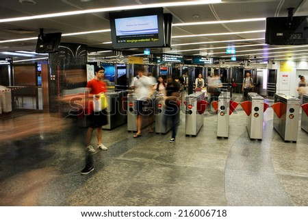 SINGAPORE - 22 Feb, 2014:Unidentified people commute at Orchard MRT station. Orchard MRT station will be an interchange station with a new Thomson line in 2021. - stock photo