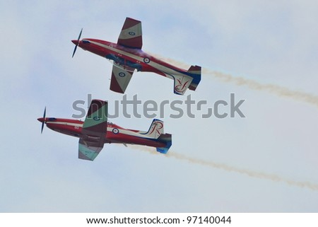 SINGAPORE - FEBRUARY 17: A pair of RAAF Roulettes showcase their airforce flying skills to the Singaporean public during Aerobatic Flying Display at Singapore Airshow on February 17, 2012 in Singapore