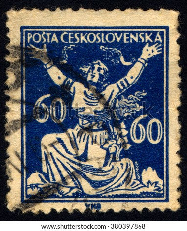 SINGAPORE - FEBRUARY 23, 2016: A stamp printed in Czechoslovakia shows Czechoslovakia Breaking Chains to Freedom, circa 1920 - stock photo