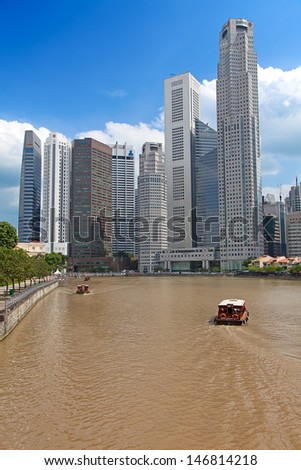 SINGAPORE - FEBRUARY 22: A tourist cruising Singapore river, on February 22, 2013 in Singapore. The Singapore River Cruise is a tourist attraction in this former British colony. - stock photo
