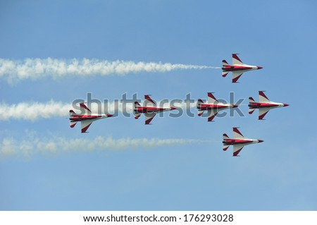 SINGAPORE - FEBRUARY 9: Aerobatic flying display by Republic of Singapore Air Force (RSAF) Black Knights at Singapore Airshow February 9, 2014 in Singapore - stock photo