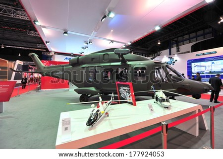 SINGAPORE - FEBRUARY 12: AgustaWestland AW149 medium-lift military helicopter on display at Singapore Airshow February 12, 2014 in Singapore