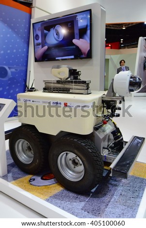 SINGAPORE - FEBRUARY 16:  Airbus Air-cobot visual inspection robot on display at Singapore Airshow February 16, 2016 in Singapore - stock photo