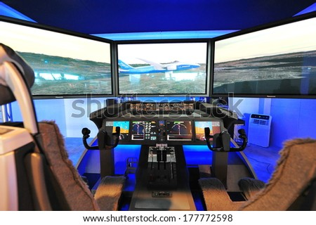 SINGAPORE - FEBRUARY 12: Boeing 787 Dreamliner cockpit demonstrator at Singapore Airshow February 12, 2014 in Singapore - stock photo