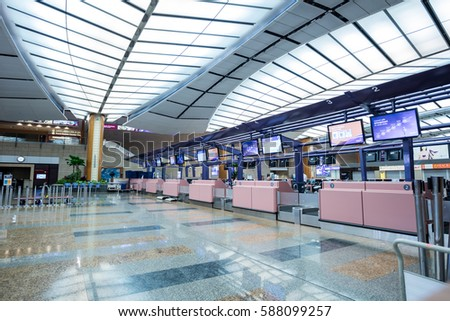 SINGAPORE, FEBRUARY 16, 2017: Check-in zone at Changi International Airport in Singapore. Changi Airport serves more than 100 airlines operating 7,000 weekly flights