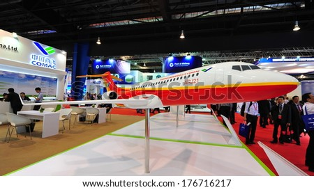 SINGAPORE - FEBRUARY 12: COMAC ARJ21 passenger jet model on display at Singapore Airshow February 12, 2014 in Singapore