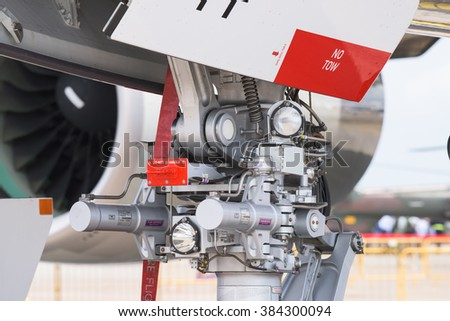 Singapore - February 16, 2016: Detail of the nose landing gear of an Airbus A380 at Singapore Airshow at Changi Exhibition Centre in Singapore.