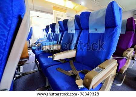 SINGAPORE - FEBRUARY 17: Economy class cabin in Singapore Airlines' (SIA) last Boeing 747-400 aircraft at Singapore Airshow on  February 17, 2012 in Singapore - stock photo