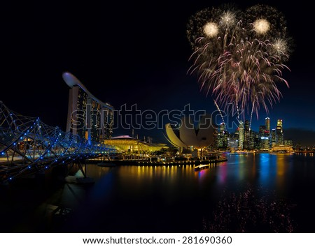 SINGAPORE  - FEBRUARY 19: Fireworks by Marina Bay Sands, an integrated resort fronting Marina Bay, February 19, 2015, Singapore. The world's most expensive standalone casino property. - stock photo
