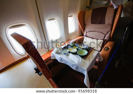 SINGAPORE - FEBRUARY 12: First class cabin in Singapore Airlines' (SIA) last Boeing 747-400 aircraft at Singapore Airshow February 12, 2012 in Singapore - stock photo