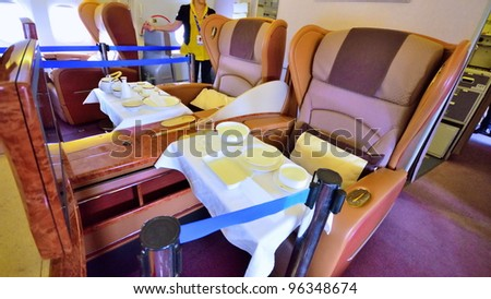 SINGAPORE - FEBRUARY 17: First class cabin in Singapore Airlines' (SIA) last Boeing 747-400 aircraft at Singapore Airshow on February 17, 2012 in Singapore - stock photo