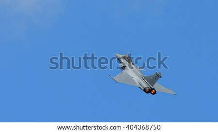 SINGAPORE - FEBRUARY 16:  French Air Force Rafale performing aerobatics at Singapore Airshow February 16, 2016 in Singapore - stock photo