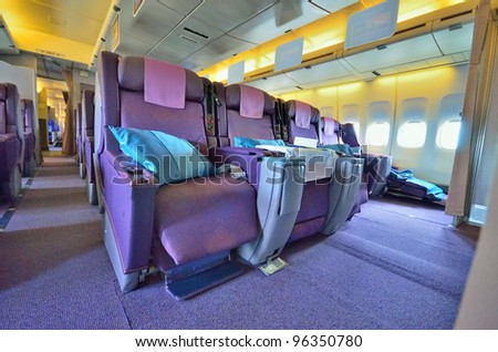 SINGAPORE - FEBRUARY 17: Front row of business class seats in Singapore Airlines' (SIA) last Boeing 747-400 aircraft at Singapore Airshow on February 17, 2012 in Singapore - stock photo