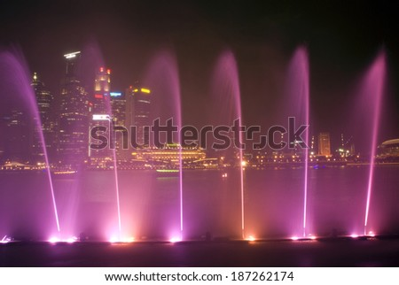 SINGAPORE - FEBRUARY 25: Laser show, February 25, 2014, Singapore. Laser show in Marina Bay is the one of the most spectacular laser shows in all over the world. - stock photo