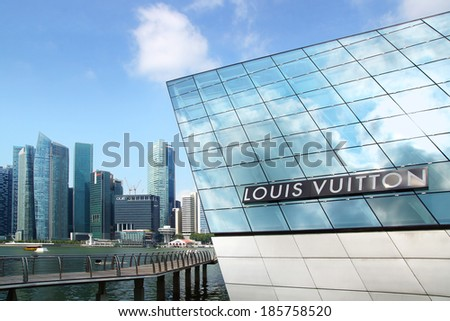 SINGAPORE - FEBRUARY 04, 2014: Louis Vuitton ��Island Maison��.The project is located in a floating�Crystal Pavilion�designed by Safdie Architects,an asymmetric building with irregularly angled facades