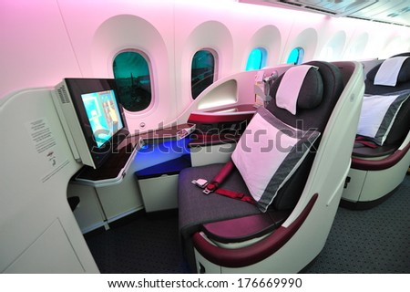 SINGAPORE - FEBRUARY 12: Luxurious and spacious business class seats in a Qatar Airways Boeing 787-8 Dreamliner at Singapore Airshow February 12, 2014 in Singapore