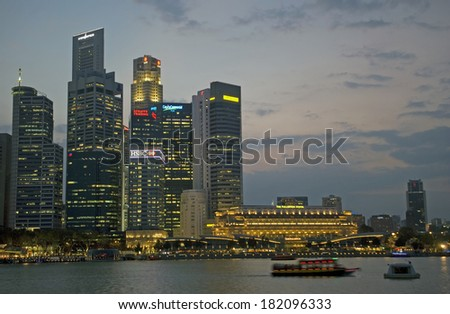 SINGAPORE - FEBRUARY 28: Marina Bay at sunset on February 28, 2014 in Singapore. The night view of Singapore is especially spectacular seen from Marina Bay.