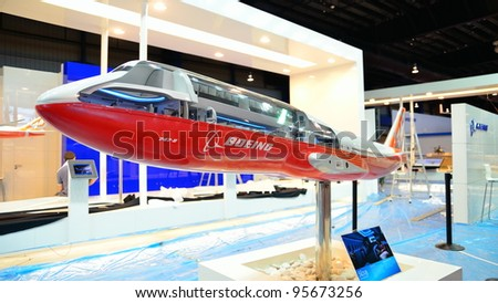 SINGAPORE - FEBRUARY 12: Model of a see-through Boeing 747-800 jumbo jet on display at Singapore Airshow on February 12, 2012 in Singapore - stock photo