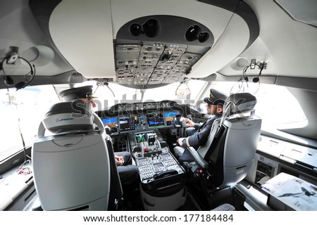 SINGAPORE - FEBRUARY 12: Modern cockpit of Qatar Airways Boeing 787-8 Dreamliner at Singapore Airshow February 12, 2014 in Singapore - stock photo