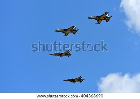 SINGAPORE - FEBRUARY 16:  RKAF Black Eagles Aerobatic Team aerobatic performance at Singapore Airshow February 16, 2016 in Singapore - stock photo