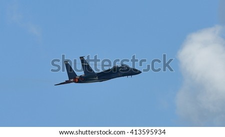 SINGAPORE - FEBRUARY 16: RSAF F-15SG figher jet performing aerobatics at Singapore Airshow February 16, 2016 in Singapore - stock photo
