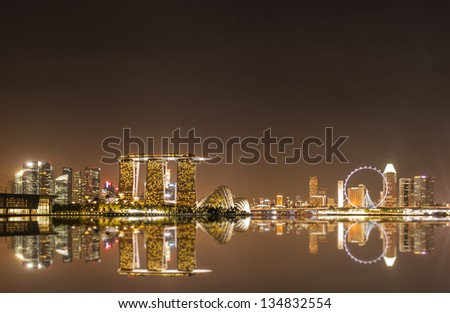 SINGAPORE - FEBRUARY 03: Scenery of Singapore Marina Bay area with its financial and tourism district, including its latest Marina Bay Sands Integrated Resort on February 03, 2013 in Singapore. - stock photo