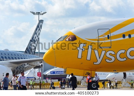SINGAPORE - FEBRUARY 16:  Scoot Boeing 787 Dreamliner parked next to rival Airbus A350-900 XWB at Singapore Airshow February 16, 2016 in Singapore