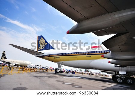 SINGAPORE - FEBRUARY 17: Singapore Airlines (SIA) showcasing its last Boeing 747-400 aircraft at Singapore Airshow on February 17, 2012 in Singapore - stock photo