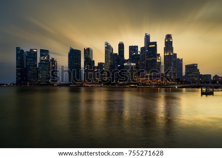 Singapore - February 10 2017: Singapore Cityscape Financial building with Dramatic Cloud in Marina Bay area Singapore at  Dusk