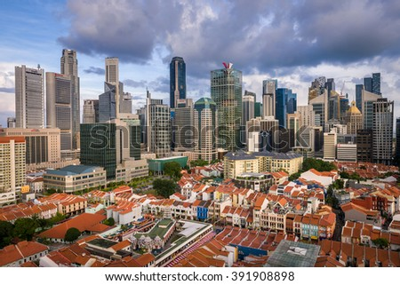 Singapore, 06 February 2016.: Singapore's modern skyline of banks and office buildings with historical buildings in foreground at sunset. - stock photo