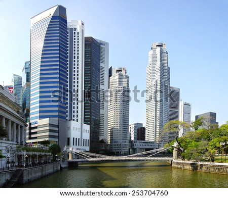 SINGAPORE - FEBRUARY 03, 2014: Singapore skyline with Cavenah Bridge. View includes next buildings: Maybank, Capital Tower, Overseas Bank Plaza, OUB Centre, UOB Plaza One, OSBC, SingTel and ect.  - stock photo