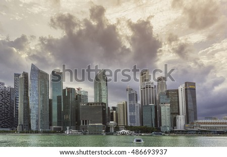 SINGAPORE, FEBRUARY 18 2015 : Skyline and modern skyscrapers of business district Marina Bay Sands at most financial developing Asian city state