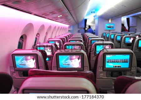 SINGAPORE - FEBRUARY 12: Spacious and comfortable economy class cabin of Qatar Airways Boeing 787-8 Dreamliner at Singapore Airshow February 12, 2014 in Singapore