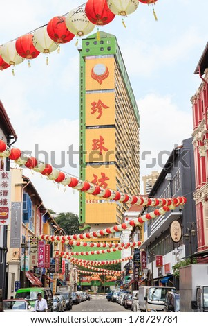 SINGAPORE - FEBRUARY 19: SStreet scene in Singapore's Chinatown on Feb 19, 2014 in Singapore. The city state's ethnic Chinese began settling in Chinatown circa 1820s. - stock photo