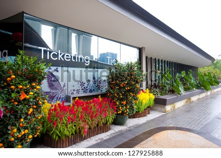 SINGAPORE-FEBRUARY 12:Ticket office for the Gardens by the Bay that spans 101 hectares of reclaimed land in Singapore, with the Marina Bay Sands hotel in reflection Singapore in Feb 12,2013 - stock photo