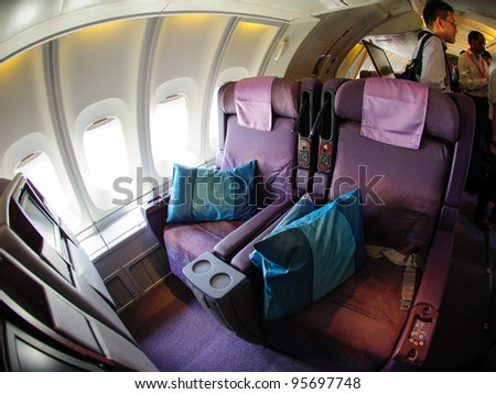 SINGAPORE - FEBRUARY 12: Top deck business class cabin in Singapore Airlines' (SIA) last Boeing 747-400 aircraft at Singapore Airshow February 12, 2012 in Singapore - stock photo