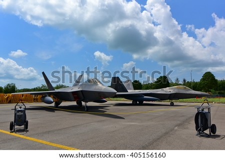 SINGAPORE - FEBRUARY 16:  USAF Lockheed Martin F-22 Raptor on display at Singapore Airshow February 16, 2016 in Singapore - stock photo