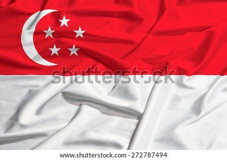 Singapore flag on a silk drape waving - stock photo