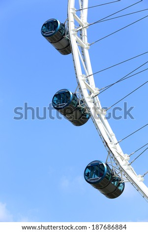 Singapore flyer with blue sky - stock photo