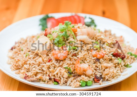 Singapore fried rice, Stir fried rice with prawn, shrimps, red pork, chicken    and vegetables - stock photo