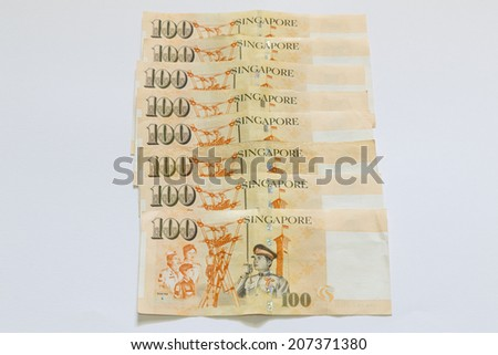 Singapore hundred dollars bank note in stack - stock photo