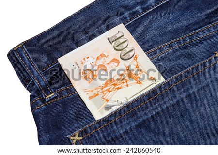 Singapore hundred dollars bank note inside jean pocket - stock photo