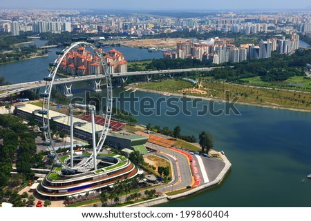 SINGAPORE-JAN 19:Aerial view of Ferris Wheel and a racing circuit at Marina Bay district in SINGAPORE on Jan 19.Marina Bay is one of best sightseeing destination in Singapore.