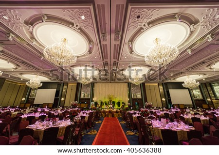 Singapore, 20 Jan 2013: Grand ballroom interior at Shangri-la Hotel with chandeliers and table setups. - stock photo