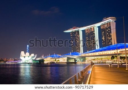 SINGAPORE-JAN 23: Marina Bay Sands Resort Hotel at night  on Jan 23, 2011 in Singapore. It is billed as the world's most expensive standalone casino property at S$8 billion. - stock photo