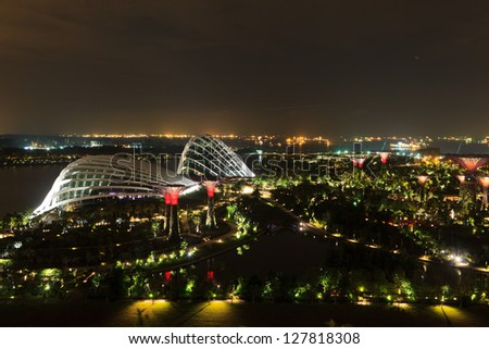 SINGAPORE-JAN 4: Night view of The Supertree Grove, Cloud Forest & Flower Dome at Gardens by the Bay on January 04, 2013 in Singapore. Spanning 101 hectares&five-minute walk from Bayfront MRT Station. - stock photo