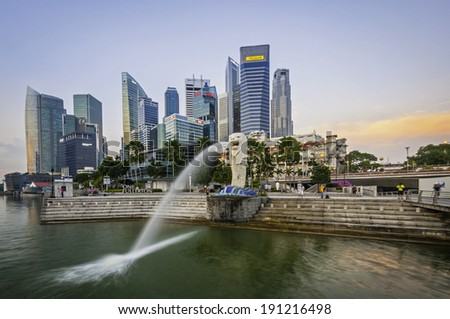 SINGAPORE-Jan,18 - The Merlion fountain and Marina Bay on morning Jan 18, 2014 in Singapore. Merlion is a mythical creature with the head of a lion and the body of a fish,and is a symbol of Singapore. - stock photo